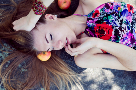 sensually: sleeping beauty: portrait of beautiful blond young woman having fun sensually smiling & looking at copy space on summer outdoors background closeup