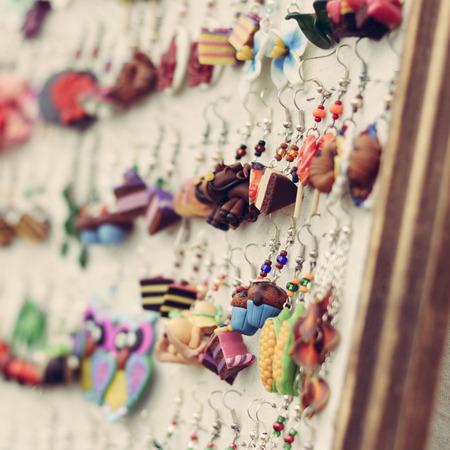 bijou: Shop display of fancy handmade bijou earrings in shape of food Stock Photo