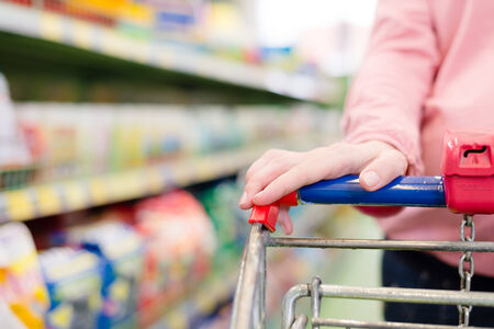 woman in a supermarket trolley carries photo