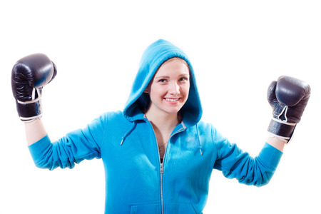 victory girl: beautiful young lady in a blue hood and gloves for boxing, kick-boxing closeup portrait isolated on white background photo