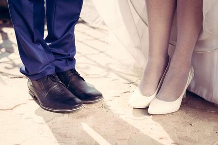 Wedding couple shoes closeup white high heeled and navy blue photo