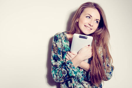 picture of happy surprised young woman with tablet pc computer photo