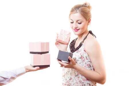 sincere: Beautiful sweet, sincere, gentle blond young woman receiving wonderful gifts in pink boxes from man