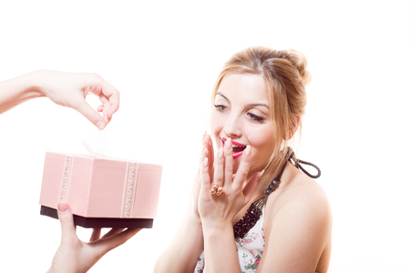 Beautiful sweet, sincere, gentle blond young woman receiving wonderful gift in pink box from man