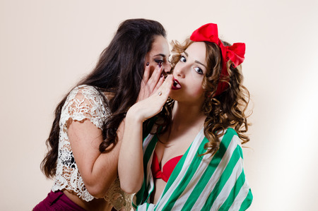 Two beautiful pin up girls have fun together photo