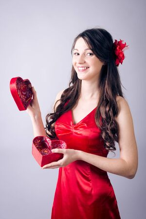 Portrait of beautiful young lady with present box photo