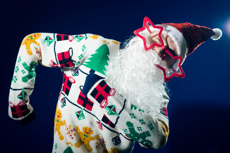 funny glasses: Funny Santa Claus dancing with star shaped glasses Stock Photo