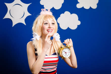 dimond: Funny woman in white wigg and toy crown holding alarm clock