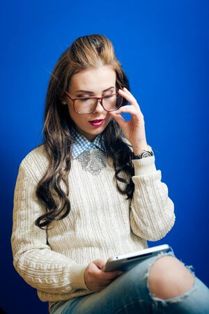 joy pad: Portrait of beautiful young lady holding tablet pc computer and glasses