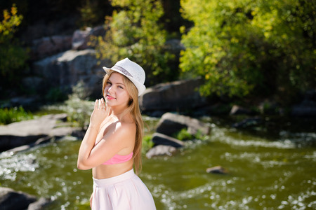 sensuality: Portrait of beautiful sensuality girl in white hat outdoors