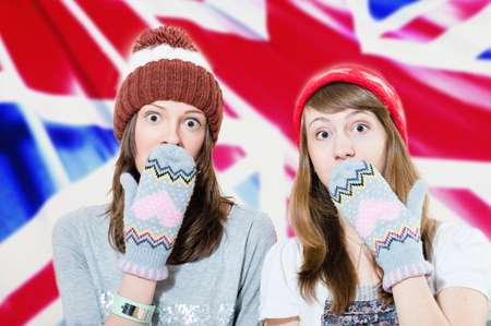 mittens: Surprised young girls in hats and mittens