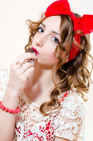 sensually: Closeup portrait of enjoying a bar of chocolate sexy pinup blond girl sensually looking at camera Stock Photo