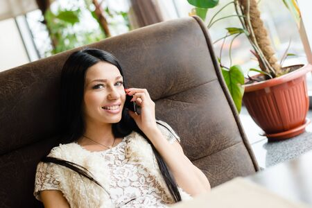 lady on phone: Portrait of happy smiling beautiful brunette young lady having fun talking on mobile cell phone Stock Photo