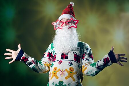 saint nick: Young man in Santa Claus costume on festival lights background