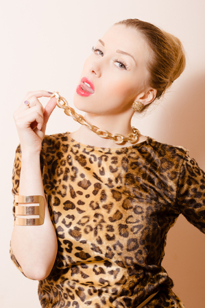 hot breast: Close up isolated picture of seductive young provocative girl in leopard print showing her tongue Фото со стока