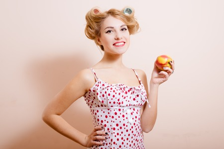 sexi: Copyspace picture of funny happy smiling sexi pinup lady holding apple and putting her hand on hip