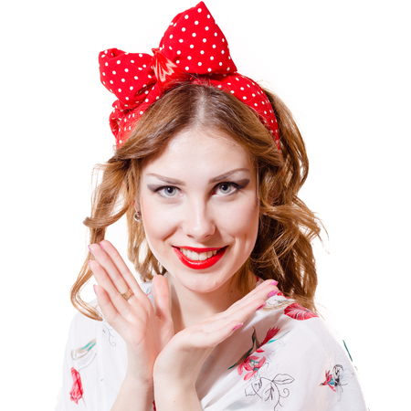red bandana: Portrait of a beautiful blond pin up girl with ponytail and red bandana  looking amazed holding her hand near her mouth isolated on white background