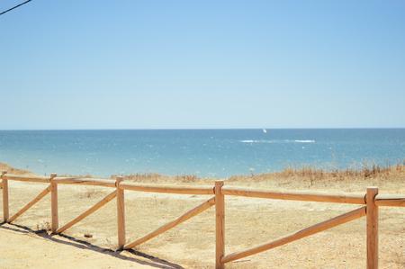 desert ecosystem: Sunny beach along the sandy coast over blue sky background. Natural landscape outdoors scenic horizon coastline