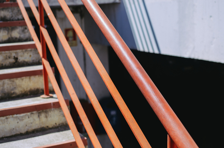 emergency stair: Staircase structure detail over gray concrete wall building abstract background