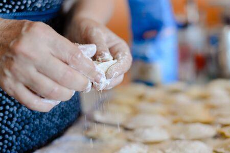 tortellini: Close up of ravioli on table background tasty traditional food. Fresh dumplings cooking preparation