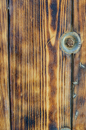Golden wood detail background. Close up photo of natural pine planks textured surface, architectural abstraction Stock Photo