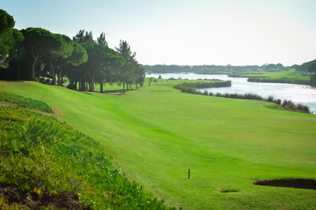 Sunny day and golf field natural scenic outdoors, bright sky background. Sunshine fitness leisure lifestyle space 스톡 콘텐츠