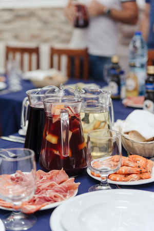 Portuguese traditional entry dishes dinner cheese, shrimps and sangria fruit wine cocktail