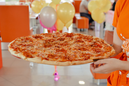 Fast food. Pizza birthday party in cafe with balloons 免版税图像