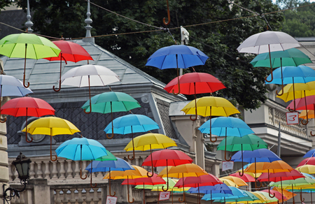 Many colored umbrellas on the street. July 8, 1916, Lviv