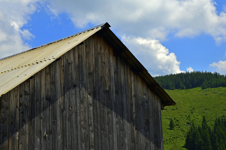 Slate roof and wall of an old wooden house Foto de archivo
