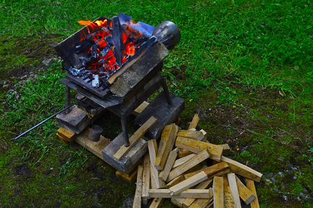 Preparing a small furnace for blacksmithing work