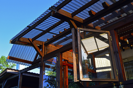 Structure of a wooden house with a translucent roof