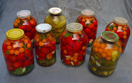 Marinated and leavened cans of tomatoes, cucumbers, peppers and other vegetables