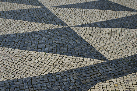 Traditional portuguese stone mosaic calcade with basalt and limestone on Lisbon, Portugal Imagens - 117755765