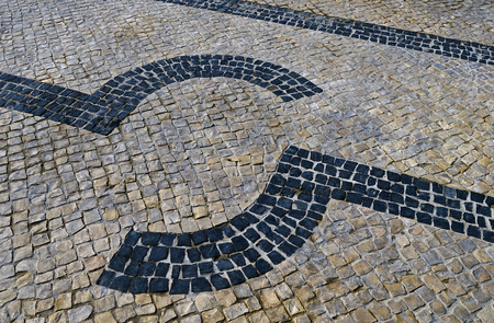 Traditional portuguese stone mosaic calcade with basalt and limestone on Lisbon, Portugal 写真素材 - 117755766