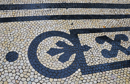 Traditional portuguese stone mosaic calcade with basalt and limestone on Lisbon, Portugal