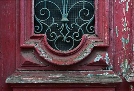 Cracked red paint on old vintage door detail. Lisboa, Portugal