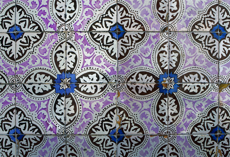 Traditional porcelain ceramic tile azulejo on the facade of the house #77-81 rua das Taipas in Lisbon, Portugal