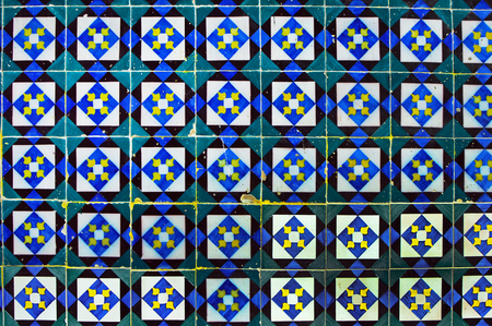 Traditional old porcelain ceramic tile azulejo on the facade of the house #14 Travessa do Fala So in Lisbon, Portugal