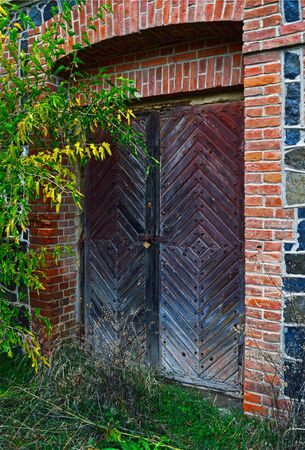 Wooden door to an abandoned old water mill building on the Southern Bug river, Vinnytsia region, Ukraine Stok Fotoğraf