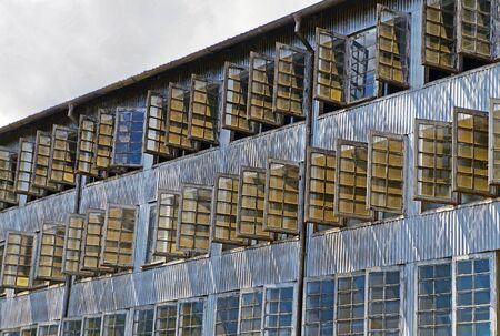 Windows on the facade of a tea factory in Munnar, Kerala, India