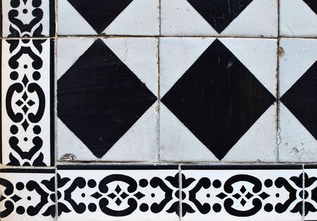 Fragment of a facade decorated with black and white tiles of azulejo. 31, street Sao Vicente, Lisbon, Portugal Stok Fotoğraf
