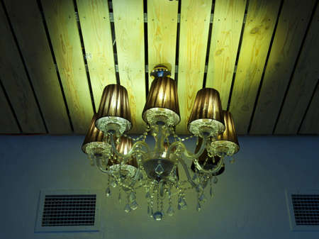 big beautiful chandelier on a ceiling photo