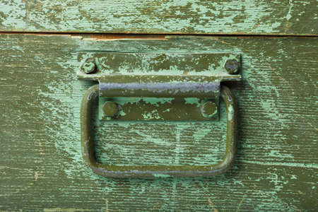 the handle on green old wooden box Stock Photo - 12667306