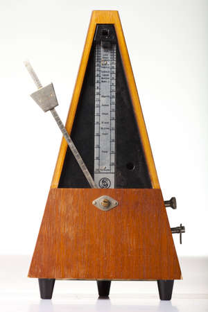 wood tick: musical metronome on a white