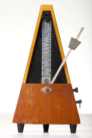musical metronome on a white photo