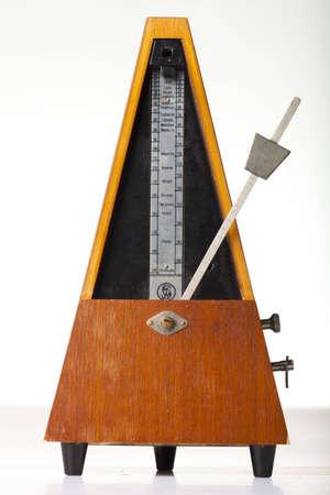 musical metronome on a white Stock Photo - 12667166