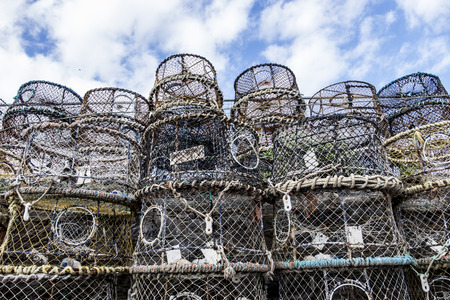 lobster pot: Rows of lobster pots against cloudy sky