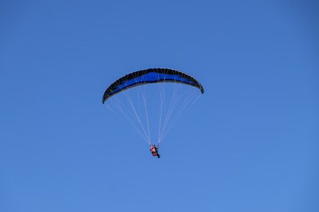 Paragliding with clear blue sky background Stock Photo