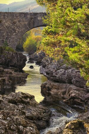 tributary: Stone bridge over the River Truim, a tributary of the Spey